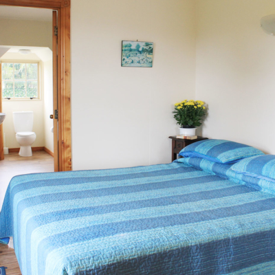 bedroom with king bed and ensuite at the carriage house kerikeri
